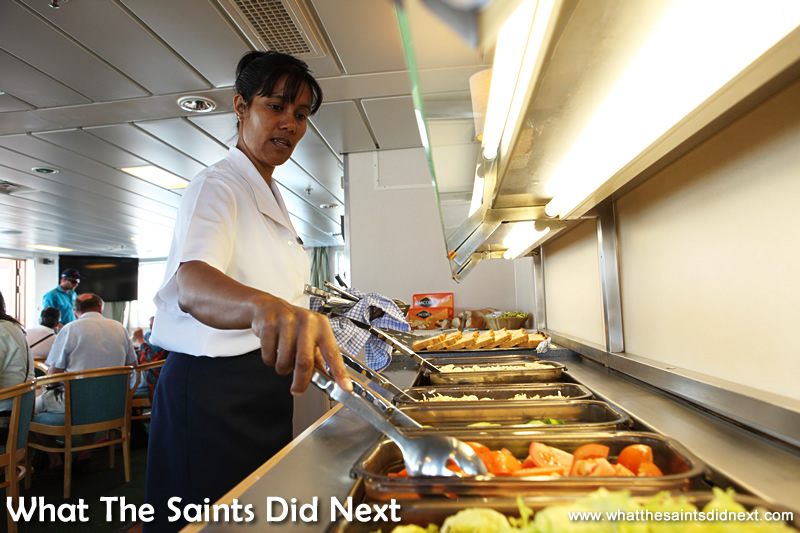Stewardess Charmaine preparing the lunch buffet in the sun lounge.