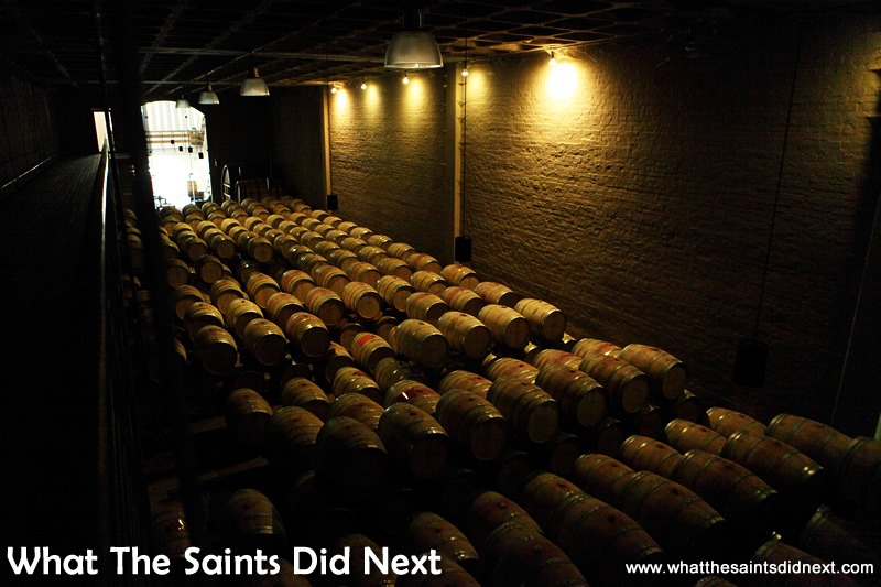 Over 300 French oak barrels filled with wine in the temperature controlled storage room.