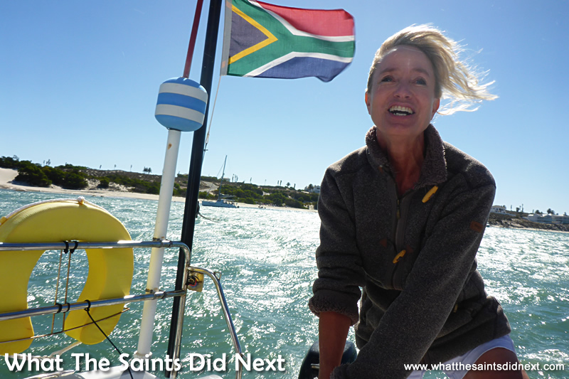 Diane taking a turn at the helm as we set off.