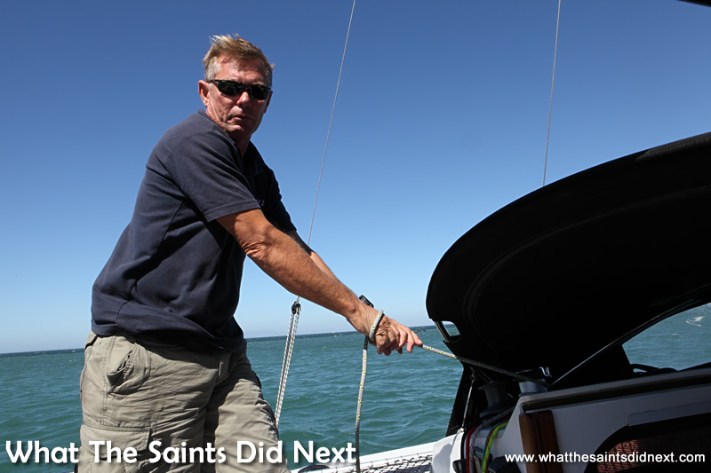 Kevin using the sail control ropes.