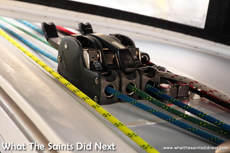 The colour coded control ropes run through a brake control.