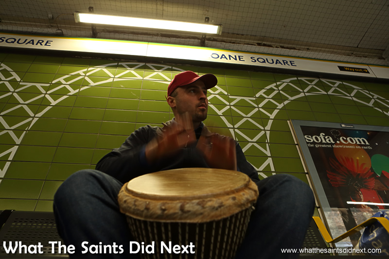 Banging the drum in Sloane Square underground station.