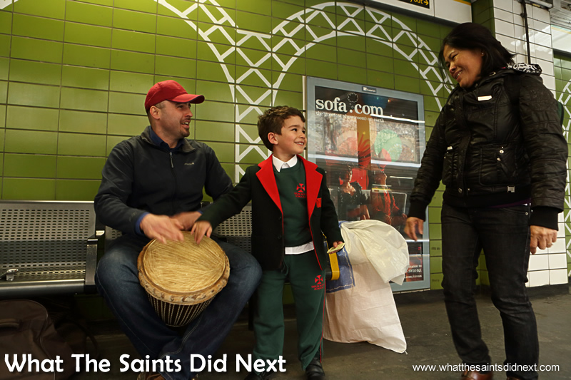 A young boy heads straight for the drum and much to his delight Dan lets him have a go.