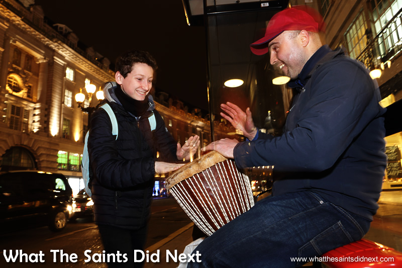 Another youngster is drawn in by the music and once again Dan allows him to have a go on the drum.