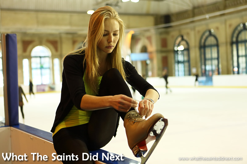 Lacing her skates; Maria has been doing this for 18 years.