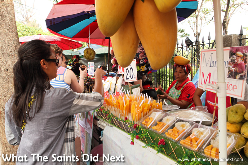 Sharon buying mango and watermelon slices.