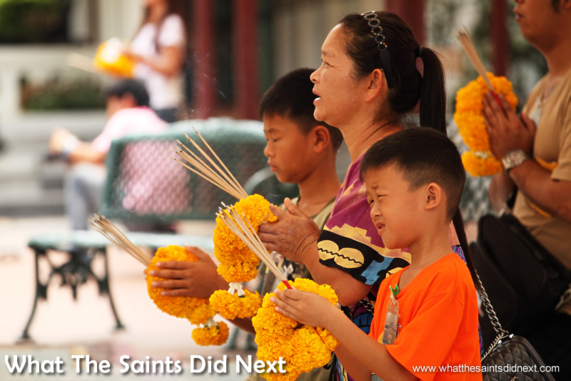 All ages make time to offer prayers at the shrine.