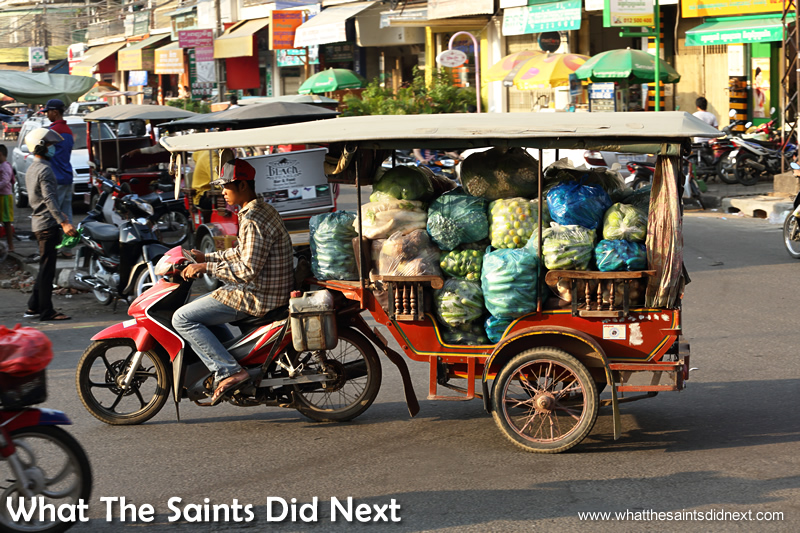 Keeping Phnom Penh moving. Who needs a white van when you have a tuk tuk.