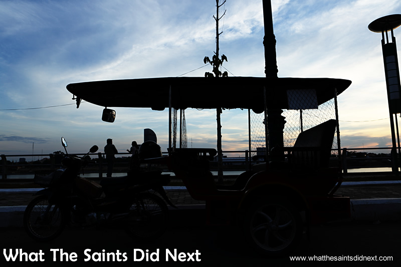 Parked up on the side of the Mekong, watching the sun set over Phnom Penh.