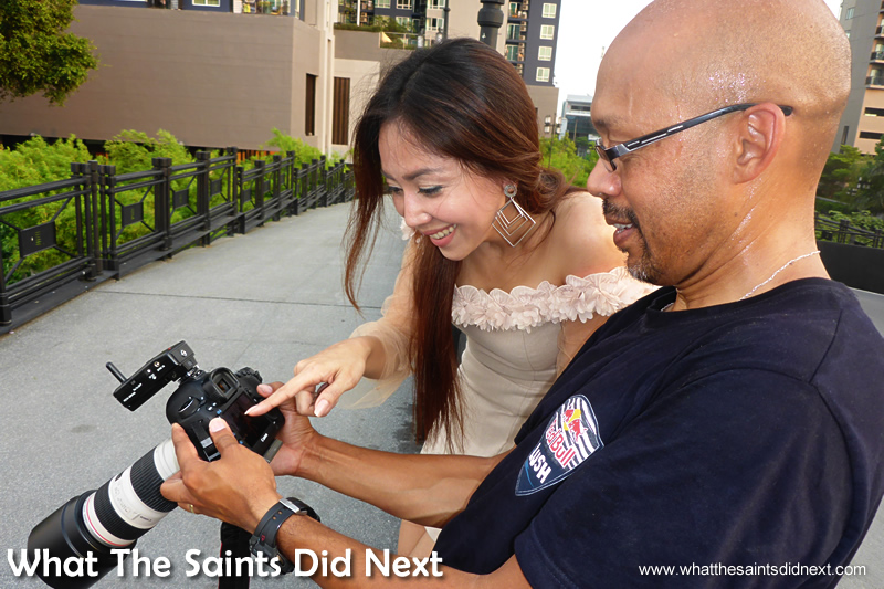 A familiar sight on a model photo-shoot - reviewing the pictures.