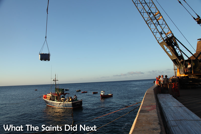 The 'John Mellis' fishing boat unloading its catch at the wharf.