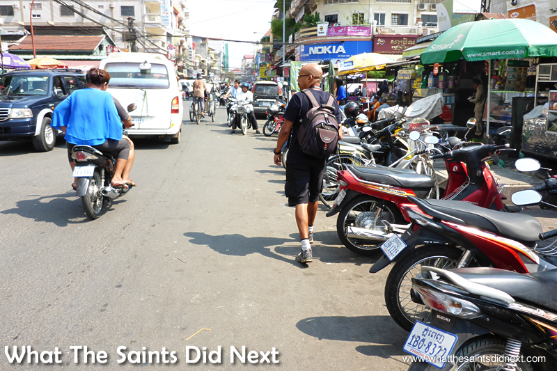 Here I am (a different day) having to walk on the street as the pavements are occupied by street vendors and mopeds.