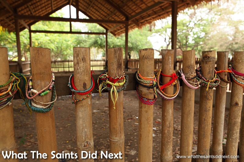 Visitors have left friendship bracelets on the bamboo fence.