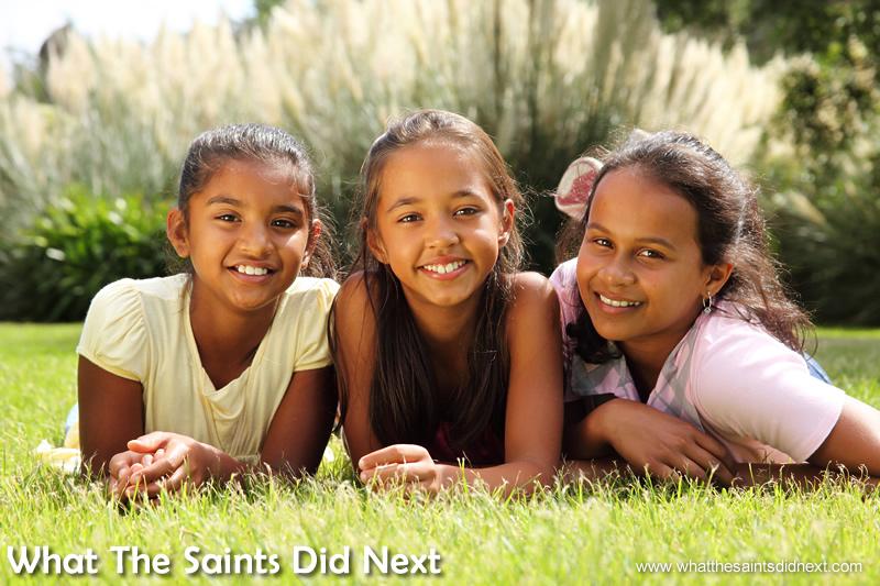 Three happy little Saint faces.