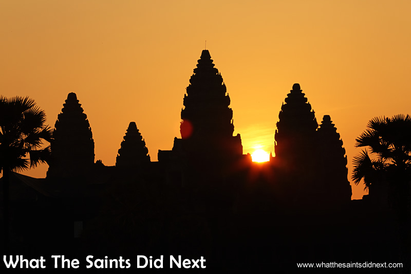 The magic moment as the sun peeks through the Angkor Wat towers.