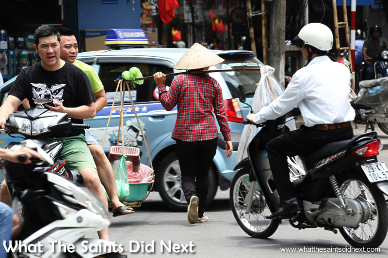 Local street sellers show no fear and just stroll right through the traffic.
