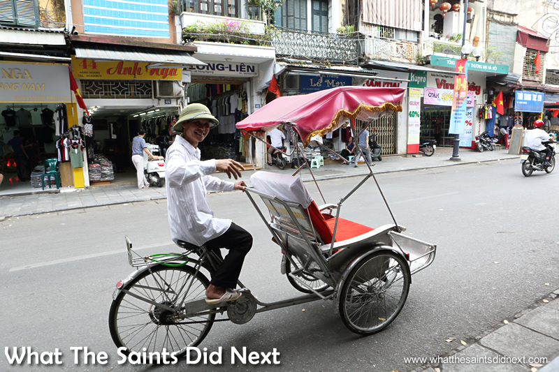 A cyclo driver calls out to offer us a city tour.