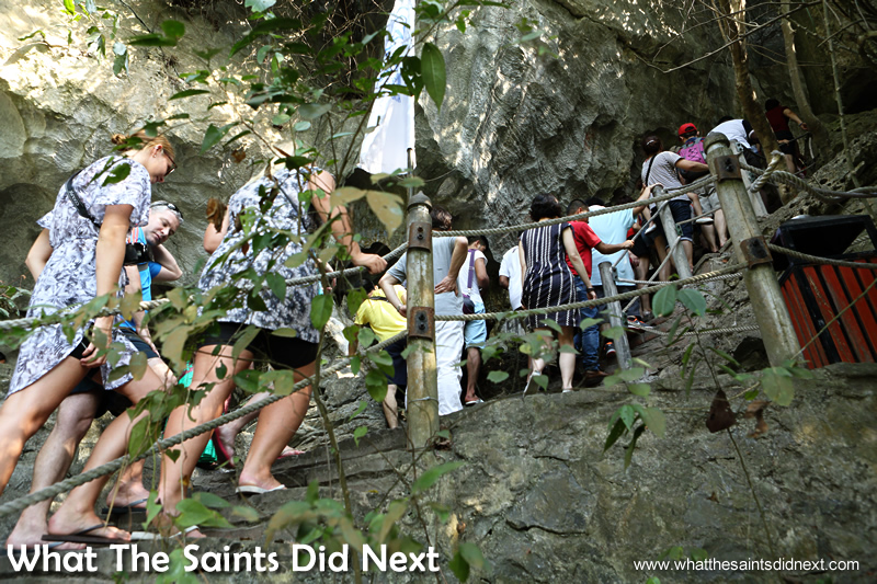 Climbing the steep, stone stairway to reach the start of the caves tour.