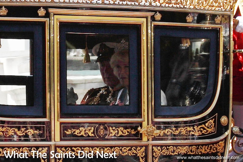 A glimpse of Prince Charles and Camilla inside one of the carriages.