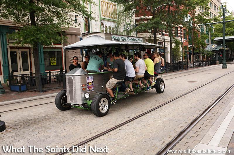 A cycle bar vehicle making its way along Main Street.