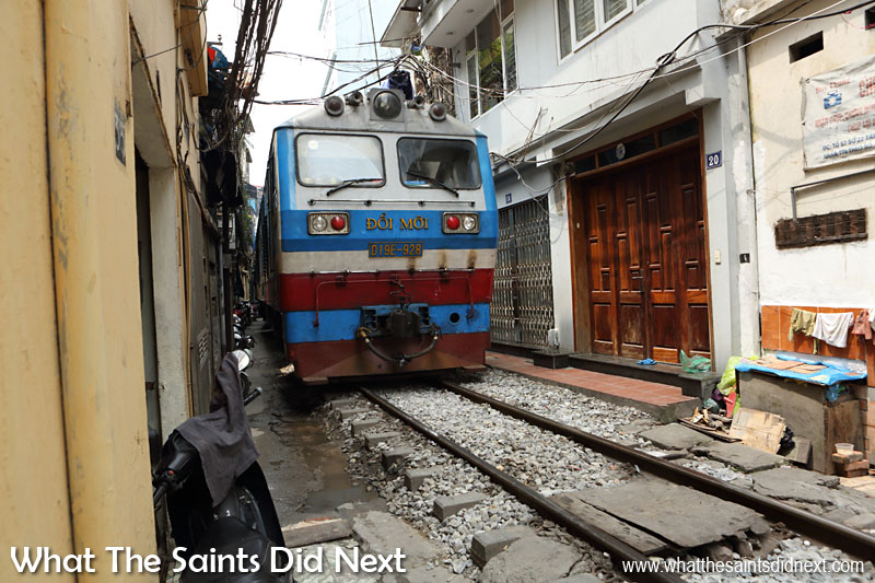 A Tight Squeeze! The Hanoi to Ho Chi Minh City train filling the gap.