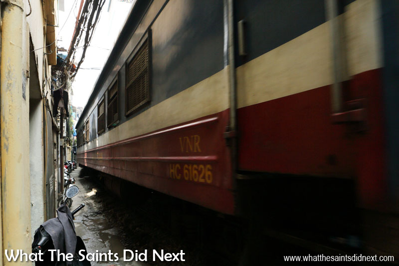 The train through Hanoi, Vietnam. Up close as the carriages whiz by.