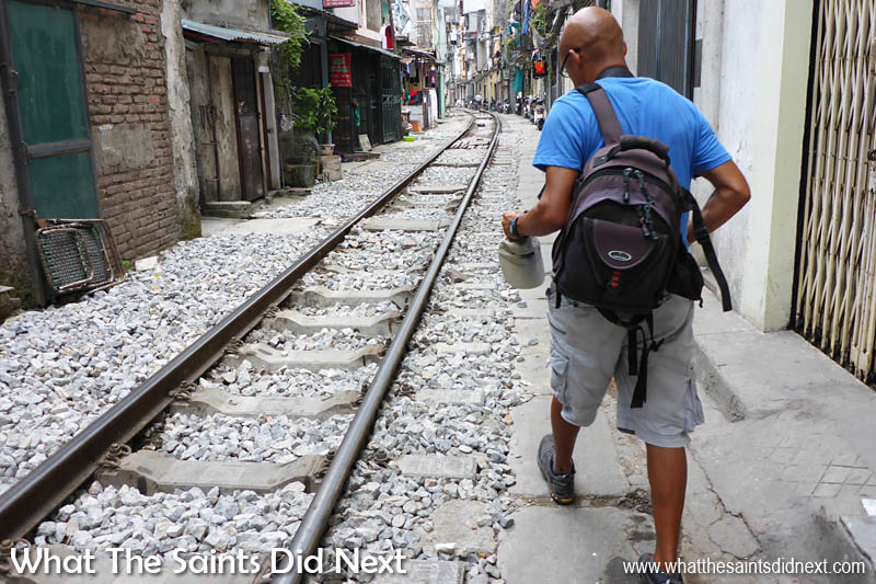 This picture shows quite clearly how little room there is on either side of the train track running through Hanoi.