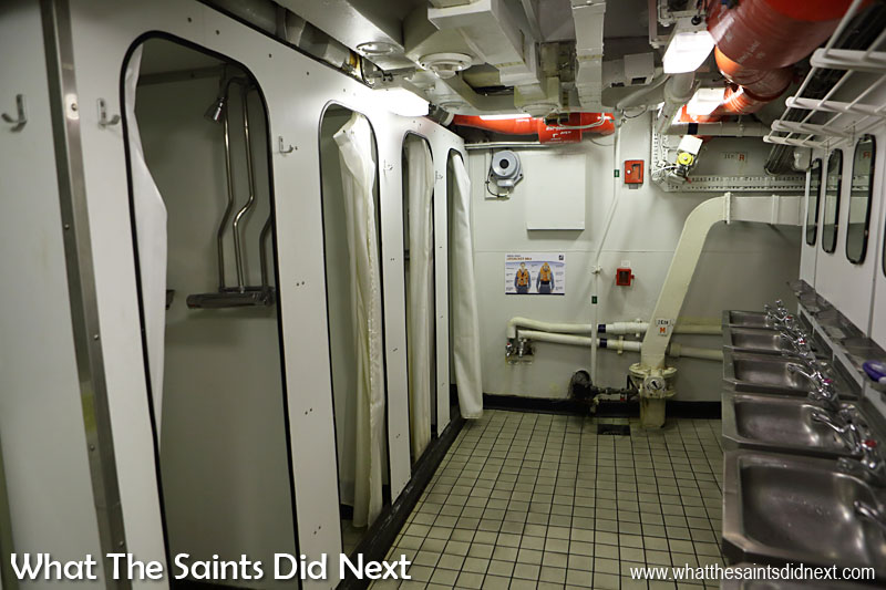 """The washroom for the senior ratings has four shower cubicles shared by 40 to 50 men, """"it gets very busy in the morning."""" Routine at sea is soon established but for one-off events such as a ceremonial parade ashore this morning, it was rather crowded in here with everyone getting ready at the same time."""