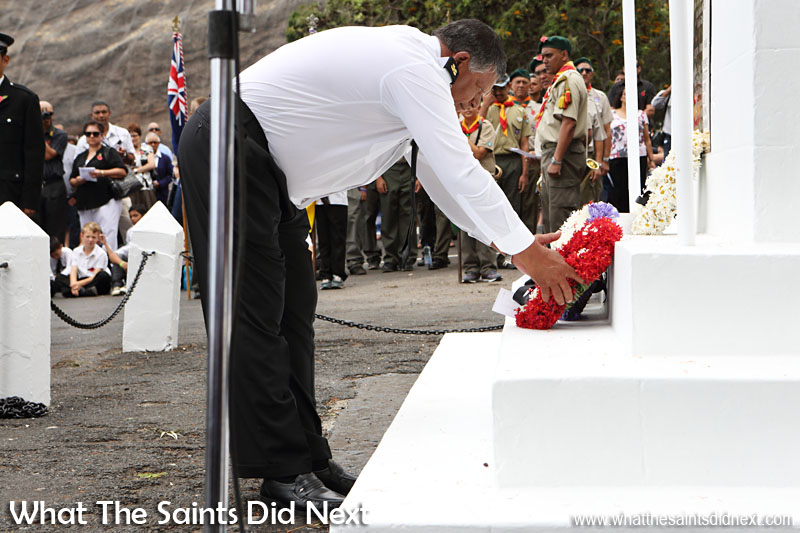 St Helena, Remembrance Day 2015. A crew member from the RMS St Helena lays a wreath on behalf of the merchant navy.