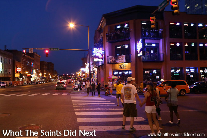 Locals and tourists alike come out to enjoy the night on Broadway in Nashville, Tennessee.