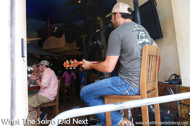 The bars, or honky-tonks, in Nashville have large window/doors that open onto the street. Anyone passing by can easily see and hear the musicians performing for the customers, and hopefully, will be tempted to come inside!