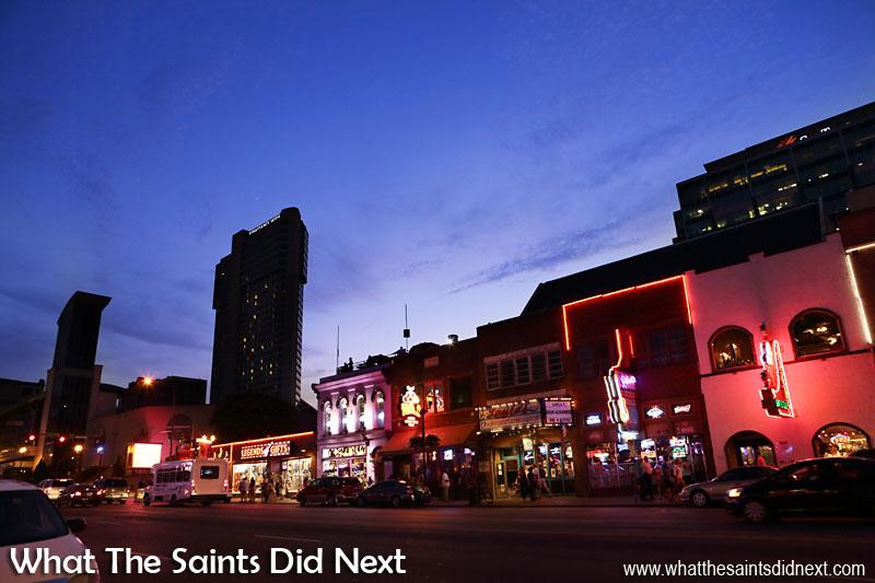 Broadway Street in Nashville as night is falling.