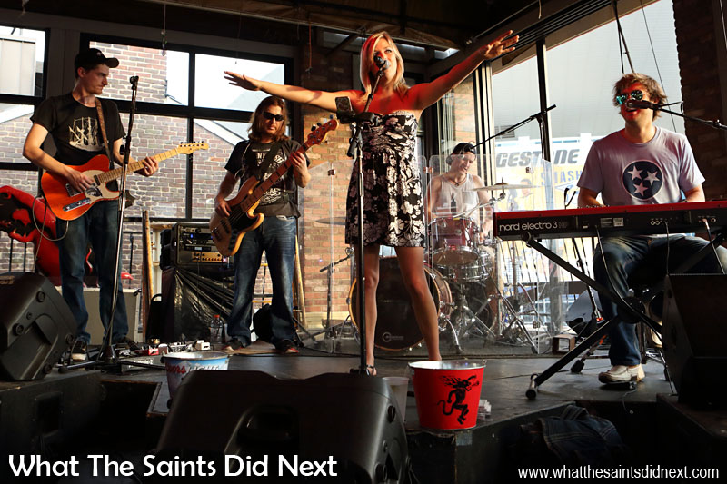 """The band really was country, don't be fooled by the rock styling. Great music to get our night started, including the hit of the moment, """"Girl Crush"""" by Little Big Town. Note the 'tips' bucket at the front of the stage."""