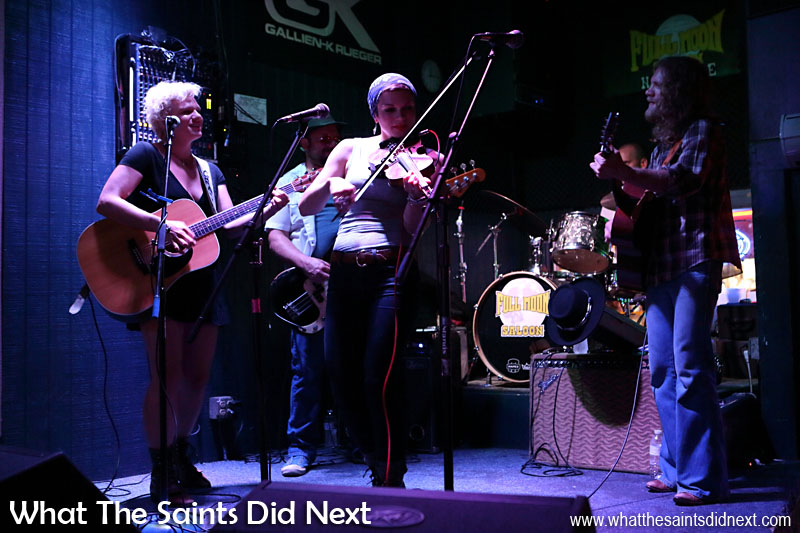 The Rische's performing in the Full Moon Saloon. The Rische family includes Scarlett (guitar), Lillie Mae (fiddle) and Frank (guitar).