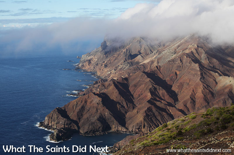 Canon 5D-MKII: 07:10, 1/250, f/14, ISO-200 The volcanic coastline of Sandy Bay on St Helena Island, photographed from on top of the Sandy Bay Barn. To capture the light (and shadows) at this time of day meant a really hike, setting off before dawn. The shape of the hills are clear to see in this picture because of the shadows defining the outline.