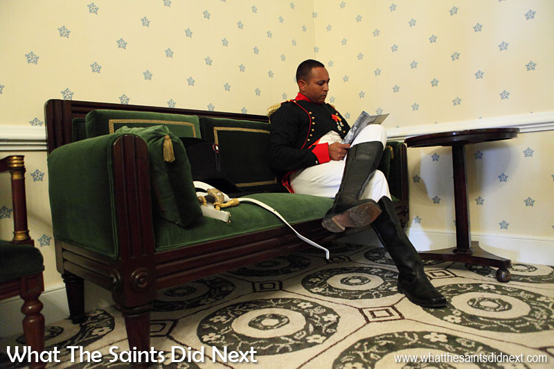 'Napoleon' reading in Longwood House. The scene in 1815 would have been very similar as the room has been restored as accurately as possible to that period, including custom made replica carpet and wallpaper and with authentic furniture pieces. This staged scene is all part of the Bicentenary re-enactment on 10 December 2015, of Napoleon Bonaparte arriving at Longwood House for the first time. The real Napoleon took up residence on 10 December, 1815.