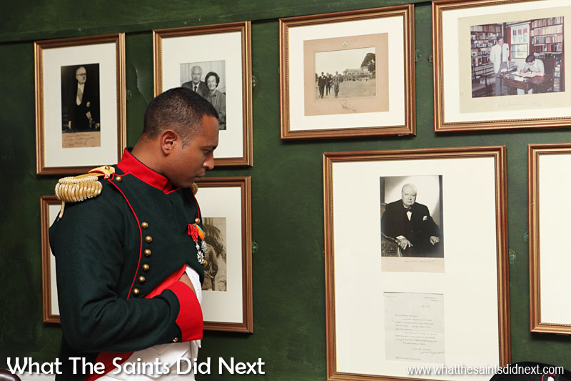 "A display of photographs inside Longwood House, St Helena, showing famous visitors over the years. Although Sir Winston Churchill never visited he did send this signed photograph and letter in 1961 as a thank you for Napoleon ""relics"" that were sent to him. The colour framed picture is of Prince Andrew signing the visitor's book in Longwood House in 1984 and alongside this is a picture of his father, Prince Phillip, walking in Longwood House grounds."