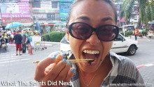 Sharon eating fried insects in Bangkok, Thailand, which we bought from a street food vendor. Just the thought still makes me shudder!