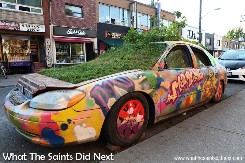 The 'garden car' was formally a 2001 Ford Taurus and has been in place on the streets of Toronto for around 10 years.  Green car is part of the Community Vehicular Reclamation Project and is the product of Rock & Adrian Hayles Productions.com.