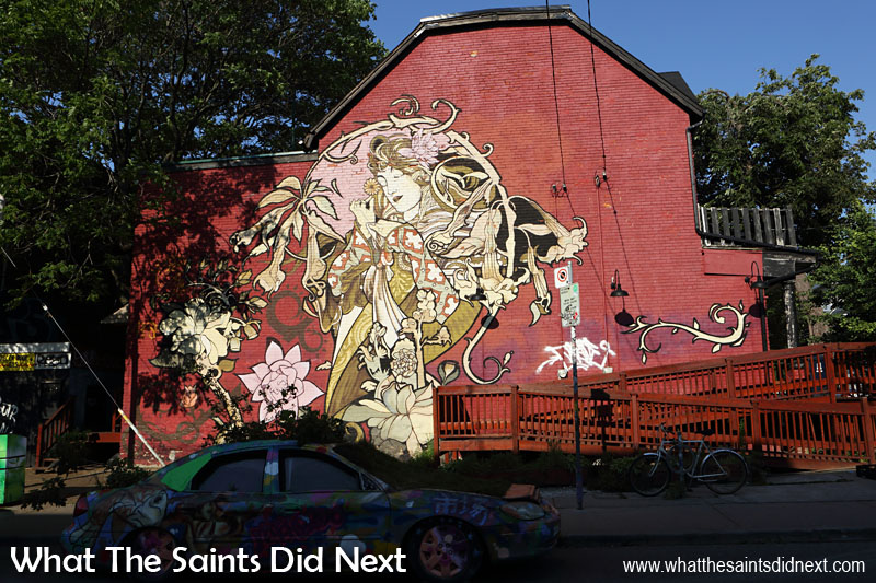 This mural of a flower lady in Kensington Market, Toronto, was the biggest we saw and the most beautiful.  She is stood next to the 'garden car'.