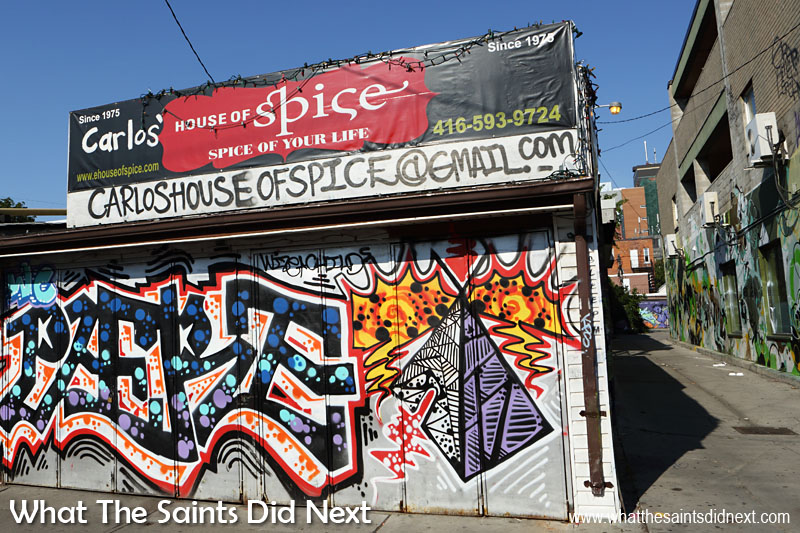 Toronto Street Art - An elaborate tag (name signature) spices up the shutters of this restaurant.