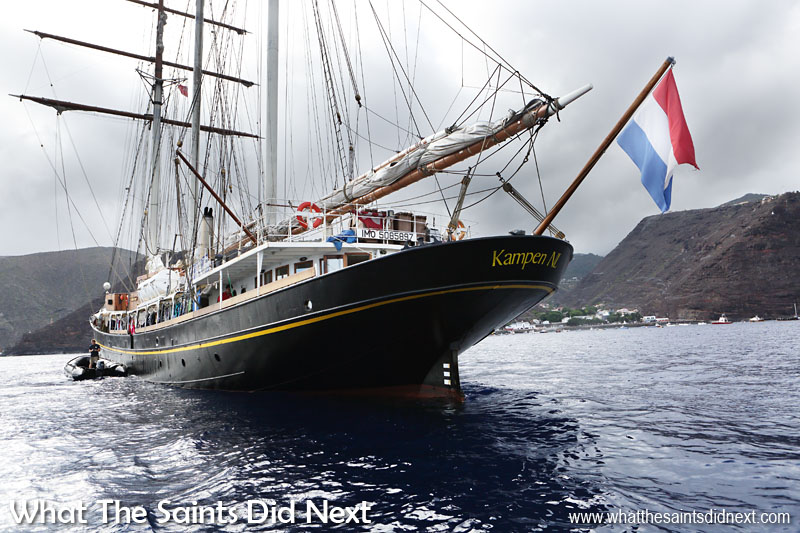 The ship is now owned by P&T Charters who converted the ship into a fast three-masted topsail schooner and renamed her as The Gulden Leeuw. This is early morning, anchored off Jamestown in St Helena.