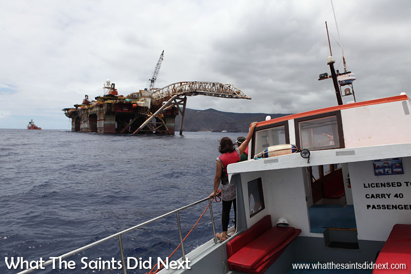 The huge hulk of the 'Castoro 7' a pipe layer platform, being towed past St Helena by the offshore tug/supply ship, 'Skandi Admiral' as viewed from the Gannet Three.