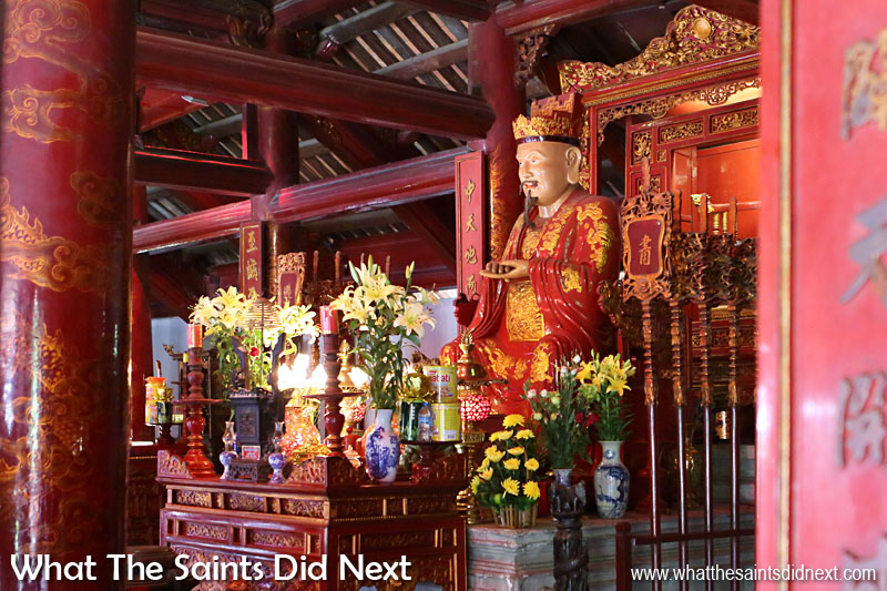 Chinese philosopher, Confucius to whom the temple is dedicated.  He founded Confucianism, which in brief is the theory on ethical behaviour of a gentleman: educating the self, organising the family, governing the state, and ruling all nations.  Quoc Tu Giam (Temple of Literature) Hanoi, Vietnam.
