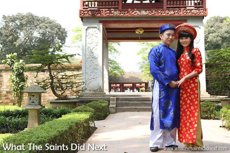 Oh to be young and in love!  Vietnamese couple posing for photos in the Temple of Literature wearing traditional dress, possibly on a pre-wedding photoshoot. Quoc Tu Giam - Hanoi, Vietnam.