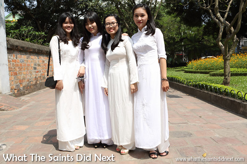 The girls dressed in matching white Vietnamese Aoi Dai costume looked stunning.  The boys were also smartly turned out and brought contrasting colourful balloons.  Excellent for photographs. Temple of Literature - Hanoi, Vietnam.