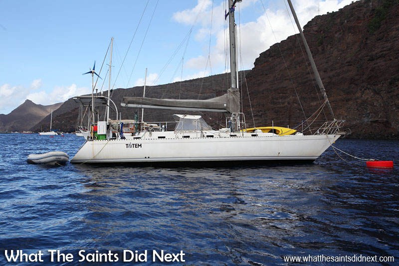 Yacht Totem moored in James Bay, St Helena. This type Stevens 47 yacht comfortably sleeps six. It makes 6 gallons of water an hour and generates electricity using sustainable solar and wind power sources.