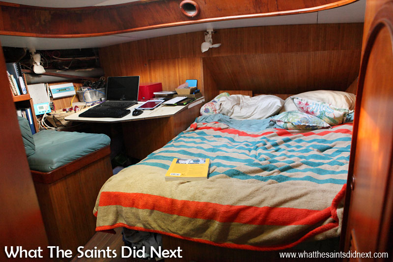 Giffords on Yacht Totem - Behan and Jamie's double cabin at the back of the boat. Every nook and cranny is used for storage. Food and books take priority over clothing!