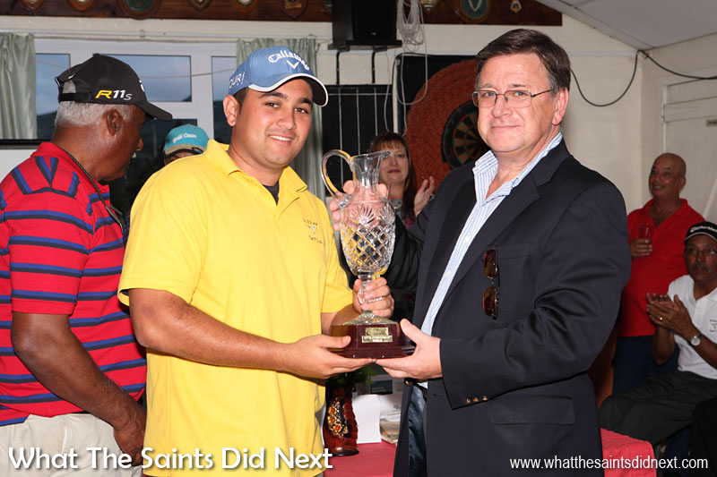 Governor Mark Capes presenting the St Helena Golf Open Champion, Scott Crowie, with the floating trophy in June 2013.