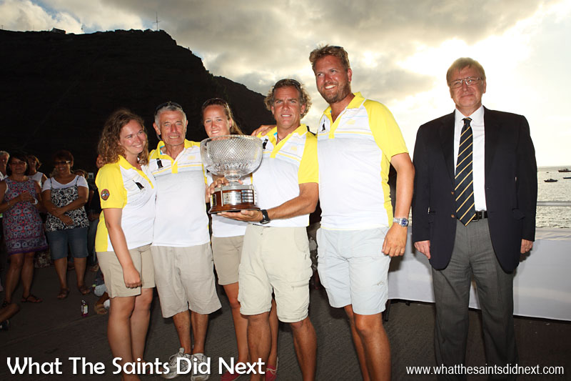 The winning crew of the yacht, Black Cat, in the Cape Town to St Helena, Governor's Cup Yacht Race, holding the large trophy just presented to them by Governor Mark Capes at the Jamestown wharf. 14 January, 2015.